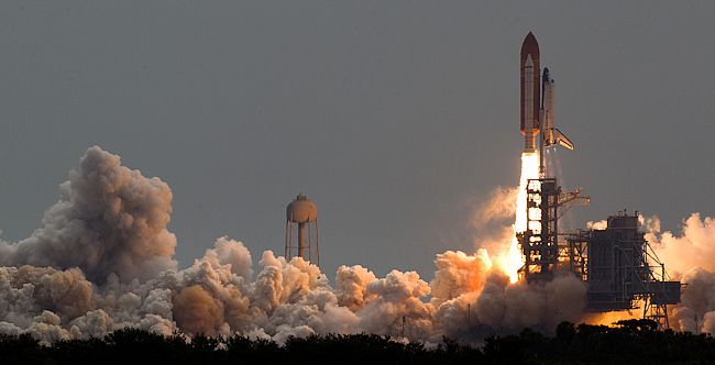 The Space Shuttle Atlantis launching from Cape Canaveral, Florida